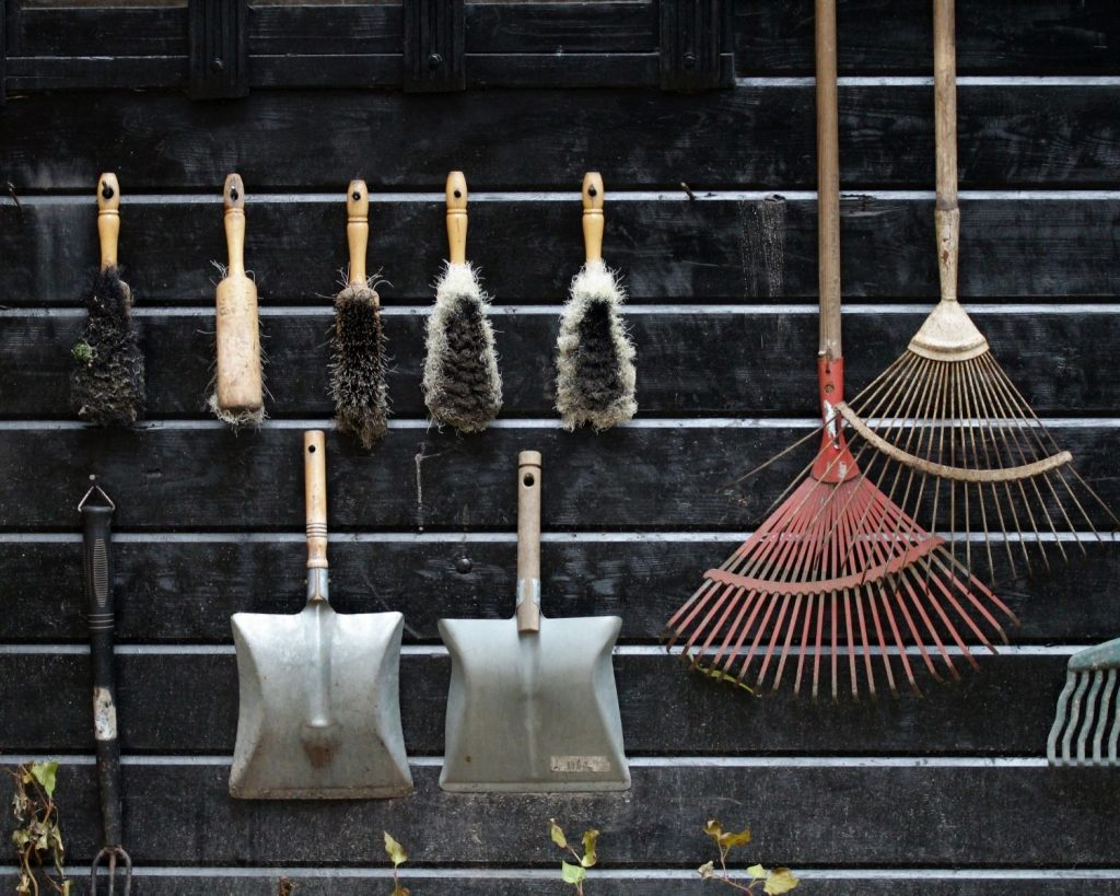 Garden tools hanging on the wall