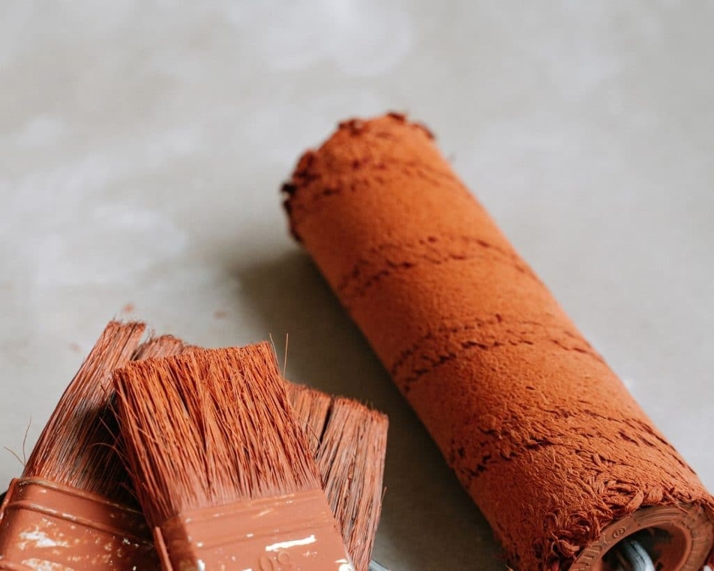 Paint Brushes & Paint Roller covered in browned paint
